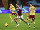 Aston Villa's Jack Grealish in action with Burnley's Ashley Westwood in the Premier League on December 17, 2020