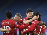 Manchester United players celebrate their second goal against Leicester on December 26, 2020