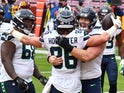 Seattle Seahawks tight end Jacob Hollister is congratulated by guard Ethan Pocic after scoring a touchdown against Washington on December 20, 2020