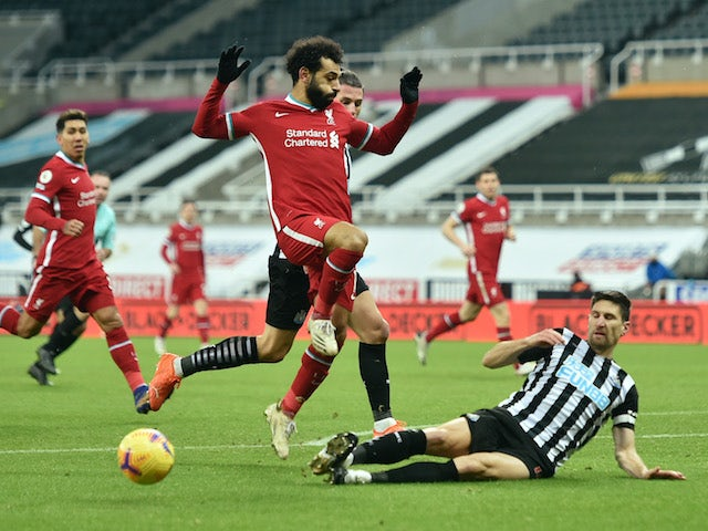 Liverpool's Mohamed Salah in action with Newcastle United's Federico Fernandez in the Premier League on December 30, 2020