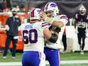 Buffalo Bills quarterback Josh Allen reacts with center Mitch Morse against the New England Patriots on December 28, 2020