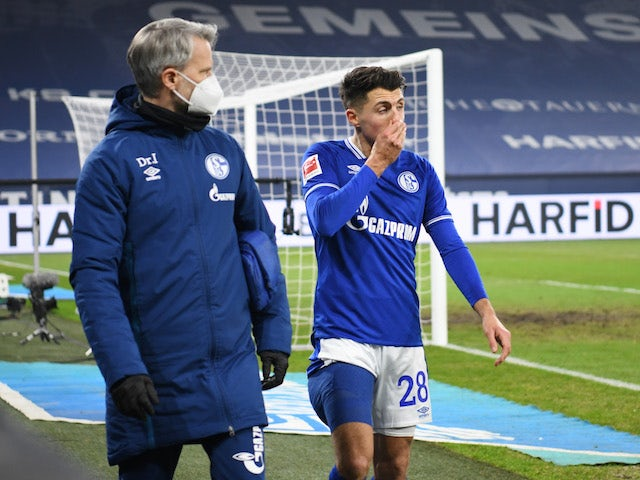 Schalke 04's Alessandro Schopf comes off as a substitute after sustaining an injury on January 9, 2021