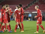 AZ Alkmaar's Albert Guomundsson celebrates scoring their second goal with teammates in October 2020