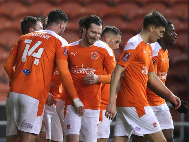 Blackpool's Gary Madine celebrates scoring their second goal with teammates on January 9, 2021
