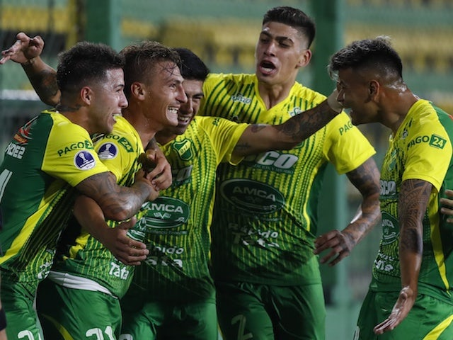 Defensa y Justicia's Brian Romero celebrates scoring their first goal against Bahia with teammates in December 2020