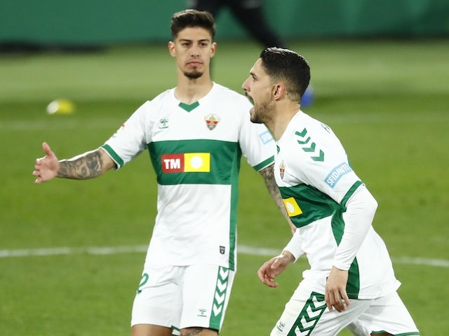 Elche's Fidel celebrates scoring their first goal with teammates against Real Madrid on December 30, 2020