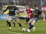 Exeter City's Matt Jay in action with Sheffield Wednesday's Liam Shaw and Ciaran Brennan on January 9, 2021