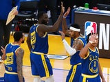 Golden State Warriors guard-forward Kent Bazemore high fives teammates after a three point basket against the Los Angeles Clippers on January 9, 2021