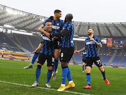 Inter Milan's Achraf Hakimi celebrates scoring their second goal with Lautaro Martinez and Romelu Lukaku on January 10, 2021
