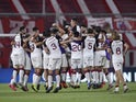 Lanus players celebrate after the match against Independiente in December 2020