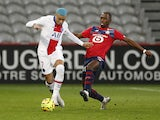 Paris Saint-Germain's Kylian Mbappe in action with Lille's Boubakary Soumare in Ligue 1 on December 20, 2020