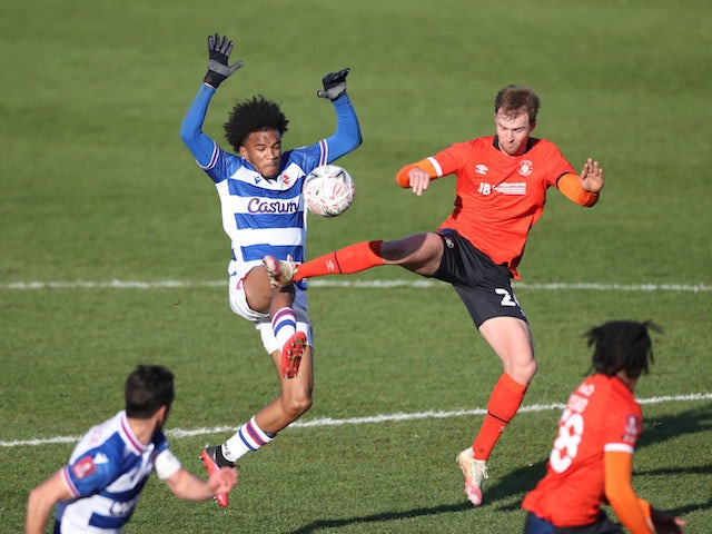 Luton Town's James Bree in action with Reading's Jayden Onen in the FA Cup third round on January 9, 2021