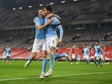 Manchester City's John Stones celebrates scoring against Manchester United in the EFL Cup on January 6, 2021