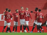 Manchester United players celebrate Scott McTominay's opener against Watford on January 9, 2021