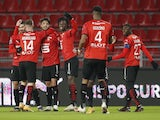 Rennes' Clement Grenier celebrates scoring their first goal with teammates on January 9, 2021