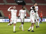 Lyon's Jason Denayer celebrates with teammates after scoring against Rennes on January 9, 2021