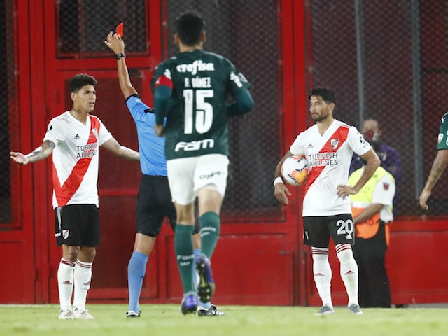 River Plate's Jorge Carrascal is shown a red card by referee Luis Gonzalez on January 6, 2021