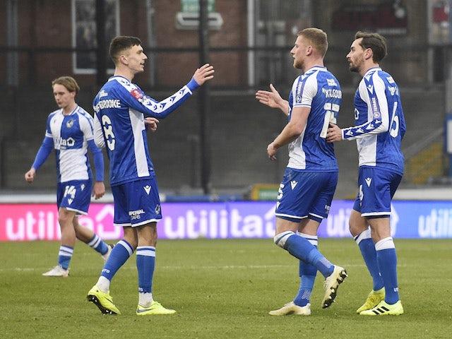Bristol Rovers' Alfie Kilgour celebrates scoring their first goal with teammates on January 9, 2021