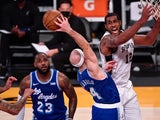 Los Angeles Lakers guard Alex Caruso tips a rebound away from San Antonio Spurs forward LaMarcus Aldridge on January 8, 2021