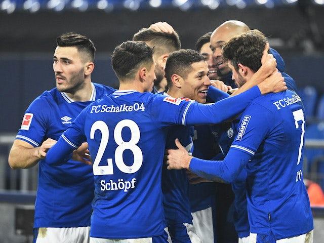 Schalke 04 players celebrate their second goal scored by Matthew Hoppe on January 9, 2021