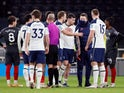 Tottenham Hotspur's Pierre-Emile Hojbjerg goes off injured against Brentford in the EFL Cup on January 5, 2021