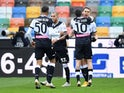 Udinese's Kevin Lasagna celebrates scoring their first goal with teammates on January 10, 2021