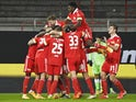 Union Berlin's Robert Andrich celebrates scoring their second goal with teammates on January 9, 2021