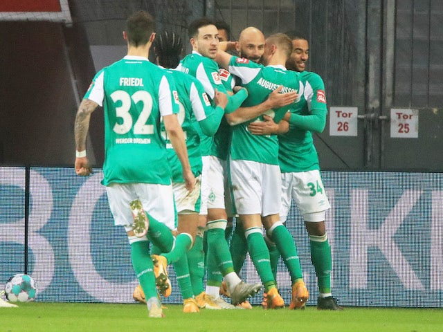 Werder Bremen's Omer Toprak celebrates scoring their first goal with teammates on January 9, 2021
