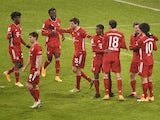 Bayern Munich's Thomas Muller celebrates scoring their second goal with teammates on January 17, 2021