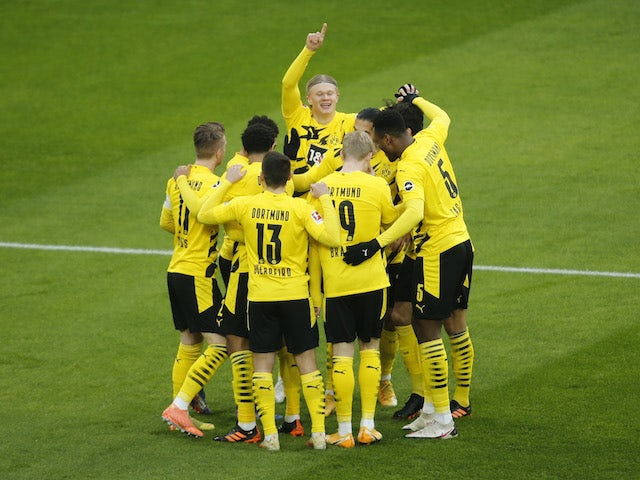 Borussia Dortmund's Erling Braut Haaland celebrates scoring a goal with teammates before it is disallowed following a referral to VAR on January 16, 2021