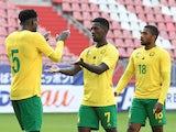 Cameroon's Samuel Gouet, Michael Ngadeu-Ngadjui and Franck Evina after the match in October 2020