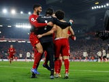 Liverpool players celebrate a goal against Manchester United in January 2020