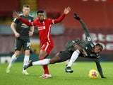 Manchester United's Paul Pogba in action with Liverpool's Georginio Wijnaldum in the Premier League on January 17, 2021