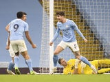Manchester City's John Stones celebrates scoring against Crystal Palace in the Premier League on January 17, 2021