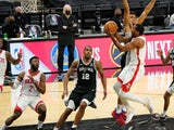 Houston Rockets guard Sterling Brown drives to the basket against San Antonio Spurs forwards LaMarcus Aldridge on January 15, 2021