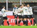 Atalanta's Cristian Romero celebrates scoring their first goal with teammates on January 23, 2021