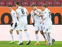FC Augsburg's Florian Niederlechner celebrates scoring their second goal with teammates on January 23, 2021