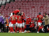 Benfica's Haris Seferovic celebrates scoring their first goal with teammates in January 2021