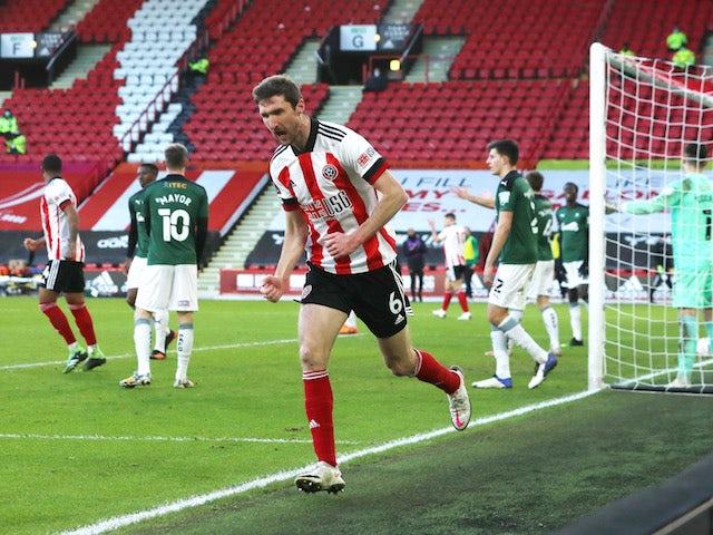 Sheffield United's Chris Basham celebrates scoring their first goal against Plymouth Argyle on January 23, 2021