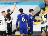 Fulham's Antonee Robinson is shown a red card against Chelsea on January 16, 2021