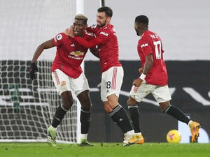 Pogba hits stunner as Man United return to summit with win at Fulham