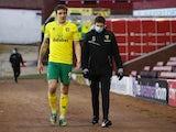 Norwich City striker Jordan Hugill limps off after an injury on January 23, 2021