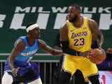 LA Lakers' Lebron James pictured with Milwaukee Bucks' Jrue Holiday on January 22, 2021