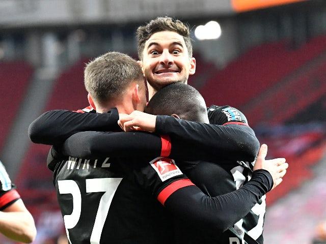 Bayer Leverkusen players celebrate Moussa Diaby's goal against Borussia Dortmund on January 19, 2021