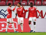 Mainz 05's Moussa Niakhate celebrates scoring their first goal with teammates in January 23, 2021