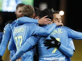 Marseille's Nemanja Radonjic celebrates scoring their first goal with teammates on January 23, 2021