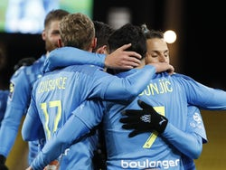 Marseille's Nemanja Radonjic celebrates scoring their first goal with teammates on January 23, 2021
