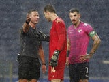 Moreirense players including Mateus Pasinato speak to the referee in January 2021