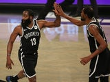 Brooklyn Nets shooting guard James Harden and power forward Kevin Durant celebrate against the Milwaukee Bucks on January 19, 2021