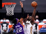New Orleans Pelicans forward Zion Williamson shoots the ball over Sacramento Kings forward Richaun Holmes on January 18, 2021